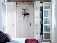 Wardrobe Ideas for Closetless Homes: flank a door with wardrobes for a built-in look, also shelf above the door