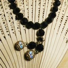 Victorian or Edwardian jet black, cut crystal bead choker. Austrian Bohemian choker with aurora borealis rhinestone rondelle dangles. This choker is a small 11 inches with a 2 inch extender and hook closure for adjustable fit. All metal findings are brass and have a lovely aged patina. This piece is in very good vintage condition. Be sure to zoom in on the images to make sure you are happy before you decide to purchase.