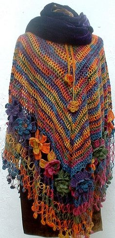 No pattern, just wonderful inspiration - looks like a long, allround version of the road trip scarf, but solomon's knots at the bottomr below the flowers, i think i can do this:)  ~  pp Crochet Colorful multicolor poncho shrug shawl Flowery | Flickr - Photo Sharing!