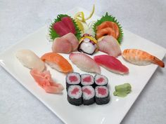 TO SHI SUSHI & GRILL in gurnee, il....great sushi thats not overpriced!! grand ave and dilleys rd behind Golden Coral.... 847.249.8899 find them on facebook @ facebook.com/toshisushigrill