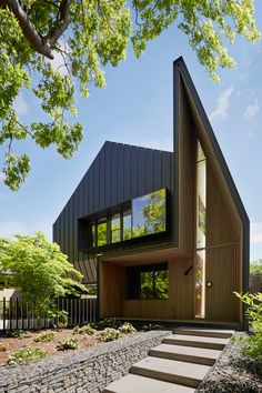 Inarc Architects have designed a black zinc clad home for a couple in Ballarat, Australia