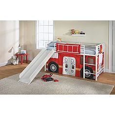 Firetruck bed. The firetruck curtain is ~$40, and the bed (with slide) is ~$250. Also needs a twin-sized mattress.