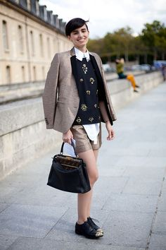 STREET STYLE SPRING 2013: PARIS FASHION WEEK - A Miu Miu sweater and tweed jacket are a cool and collected pairing.