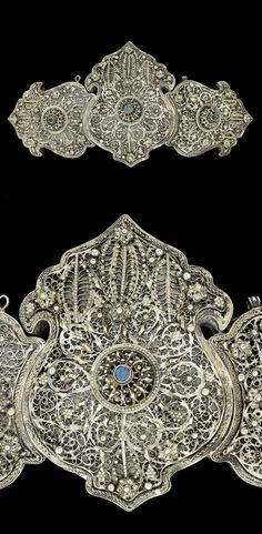 Balkans | Ottoman silver filigree belt buckle, with central blue glass cabochon…