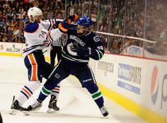 CrowdCam Hot Shot: Vancouver Canucks forward Brandon Defazio is checked by Edmonton Oilers defenseman Darnell Nurse during the third period at Rogers Arena. The Edmonton Oilers won 4-1. Photo by Anne