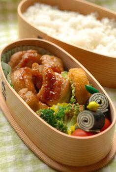Japanese Bento Box Lunch with Chicken Teriyaki, Nori Cheese Roll, Broccoli Gomaae Sesame Salad