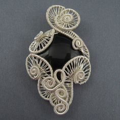 Wire wrapped pendant tutorial by gay jewelry pinterest carnival pendant wire weave tutorial weaving swirl shapes mozeypictures Image collections