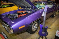 Aimee Chamberlain's Violet 1971 Plymouth Road Runner was paired with a purple guitar by G&L Musical Instruments during the recent 2014 Muscle Car and Corvette Nationals in Rosemont.