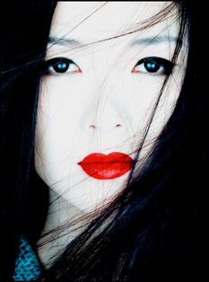 By Albert Watson (Zhang Ziyi for Memoirs of a Geisha); note that the eyes are not the enhanced light green that they are on the movie poster.