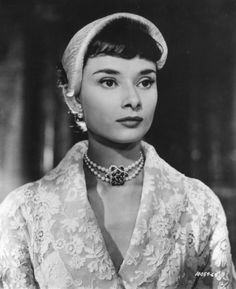 Audrey looking regal in Roman Holiday. Her brows are smaller here.