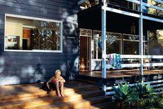 blue/grey exterior colour, wood deck