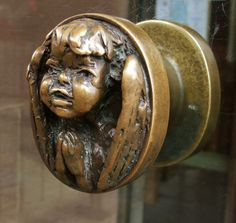 A little cherub door handle in the Coventry Cathedral - England -- The door handles were designed by Sir Jacob Einstein. Door Knobs And Knockers, Knobs And Handles, Door Handles, Cool Doors, Unique Doors, Coventry Cathedral, Antique Door Knobs, Door Detail, Door Accessories