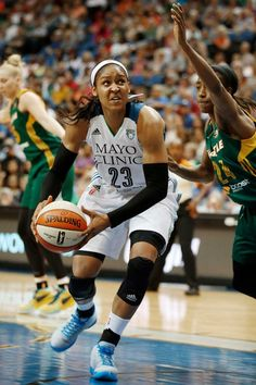 Minnesota Lynx forward Maya Moore (23) looks up to the basket against the defense of Seattle Storm guard Jewell Loyd (24) during the first half of a WNBA basketball game, Friday, July 3, 2015, in Minneapolis. Photo: Stacy Bengs, AP / FR170489 AP