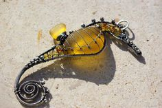 GOLDEN YELLOW seahorse wire wrapped seaglass pendant.