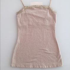 """Express Tank With Built In Bra Express tank with built in bra. Size medium. Cream/oatmeal color with sequins sewn into lace trim. Adjustable straps. Great condition. Shirt measures 21.5"""" from top of lace to bottom and 13"""" across middle. No trades! Bundle to save! Thank you! Express Tops Tank Tops"""