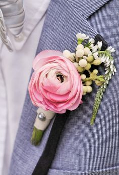 Pink ranunculus boutonniere.