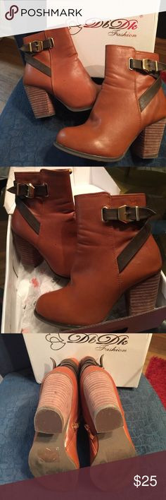 DBDk Fashion Elegant foot wear Booties Size 7 DBDk Fashion ..Elegant foot wear Cognac Booties Size 7..Very stylish women cognac Booties to be worn with a dress, skirt or jeans of your choice ..barely worn and still in the box DbDk Fashion Shoes Ankle Boots & Booties
