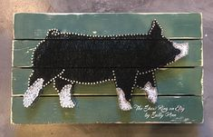 Ms. Berk is a highly detailed, life-like string art rendition of a berk or Berkshire show pig. She measures approx 17 1/2 inches x 9 1/2 inches. Each animals boards are hand painted both front and back for a complete finished look and are hand distressed. Custom orders are available of any breed/species/sex. You may submit a photo and I will match the marking on your animal as close as possible. There will be an additional cost for custom items. I can also make larger renditions of any of…