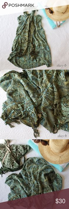 "Olive Green and Aqua Tie Dye Sarong The colors in this sarong are absolutely beautiful!  A very substantial weight material in shades of olive and aqua. Measures 46""x58"". Check out YouTube for all the different ways to wear your sarong. Also known as a pareo. The cover shot is my favorite way to wear it. Machine wash, hang on rack to dry. Swim Sarongs"