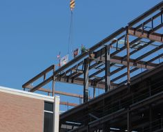 Getting the final beam into place at the Spencer Fox Eccles Business Building at the David Eccles School of Business on the University of Utah campus.