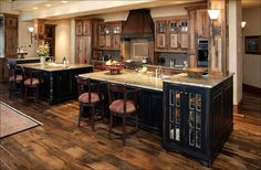 Love this kitchen. The separated bar allowing space to walk through the kitchen and the cabinets to store the plates right at the bar. Very beautiful.