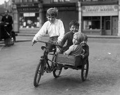 children Having fun...vintage side car bicycles,