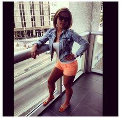 This is cute Neon orange shorts  & acid wash jean jacket .<3