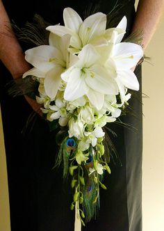 Pretty lily bouquet minus the peacock feathers.