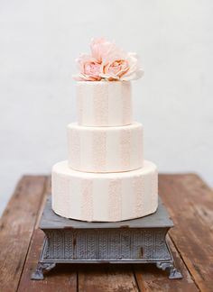 Love the soft pink and white stripe on this cake.  Perfect for a wedding, a birthday or Spring!