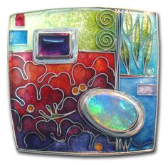 The pictured brooch is cloisonne enamel on fine silver, with a pear shaped crystal opal and a rectangular amethyst, set in a sterling silver frame 36mm x 36mm.