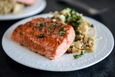 Broiled Salmon and Roasted Garlic Cream Noodles with Crispy Cauliflower + Toasted Pine Nuts.