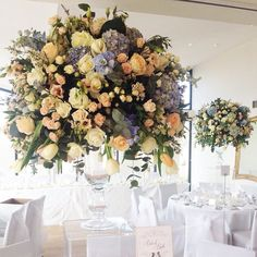 Bring romantic color to white weddings with magnificent floral arrangements like these