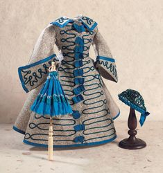 """Theriault's Antique Doll Auction, Silk Shantung Gown 1860c 14"""" or 15"""" Poupee, along with a Bone-Handled Silk Parasol and Royal Blue Snood, Realized Price $1,300"""