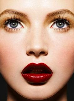 Bright eyes and dramatic lips enhance this holiday makeup look
