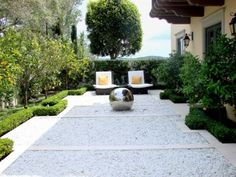 Modern Formal Garden   AMS Landscape Design Studios, Inc. by AMS Landscape Design Studios, Inc.  Today, the formal parterre garden can be modified to fit any design scheme. We love how this example contains many traditional elements but is comfortable for lounging and contains modern touches that fit with the design scheme of the rest of the house.