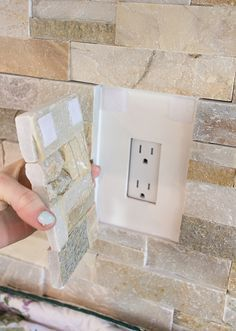 Kitchen Chronicles: Stacked stone bar wall- hiding an outlet on an accent wall with velcro?! GENIUS!!
