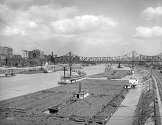Pittsburgh, PA: Coal barges on the Monongahela River with the Wabash Bridge in the background. The Wabash Bridge was a railroad bridge across the Monongahela River at Pittsburgh. Constructed between 1902 and 1904 by railroad magnate George J. Pittsburg Pa, Steam Boats, Industrial Photography, Ohio River, Tug Boats, Best Places To Live, Pennsylvania, Travel, Railroad Bridge