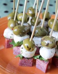 Easy Appetizer: skewer an olive, a mini marinated mozzarella ball, and a quarter of a thick sliced salami or pepperoni