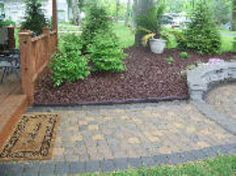 Using Rubber Mulch For Low Maintenance And Rubber Curbs To Retain The Mulch.