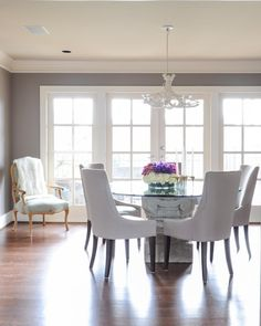Feast Your Eyes: Gorgeous Dining Room Decorating Ideas - This home has two distinct dining spaces, with one area for eating and one for entertaining. This separation makes it easier to enjoy each space to the fullest.