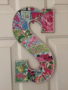 "Lilly Pulitzer letter ""S"". I used pages from my old agendas and modge podged them on (and added on top for a glossy finish). Small sized pearls were added for a border. #lilly #diy"