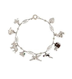 Mann's Jewelers An Art Deco charm bracelet comprised of 9 whimsical charms, including a swimmer, a barrel, a four-leaf clover, a heart, a swan, an airplane, a donkey, a rabbit, and a house, in platinum (atw. 0.42 ct. single cut and rose cut diamonds).