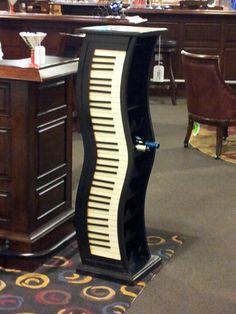 Piano keyboard wine rack.
