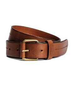 Tawny brown. PREMIUM QUALITY. Leather belt with a decorative seam along the center. Metal buckle. Width 1 1/4 in.