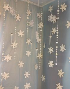 Snowflake curtain party backdrop. Diy out of doilies taped on fishing line.