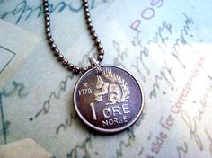 Norwegian squirrel coin at https://www.etsy.com/listing/90264792/coin-jewelry-vintage-squirrel-coin-from