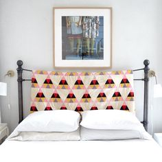 The master bedroom of this Georgia Home has a quilt hanging on the headboard. Photo at Design*Sponge Casas Na Georgia, Home Bedroom, Master Bedroom, Bedroom Ideas, Quilted Headboard, Headboard Cover, Cloth Headboard, Headboard Ideas, Headboards