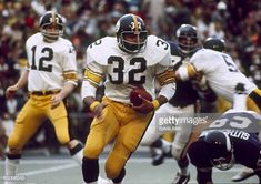 9385278a990 Pittsburgh Steeler Hall of Fame running back Franco Harris on a run through  in a 166