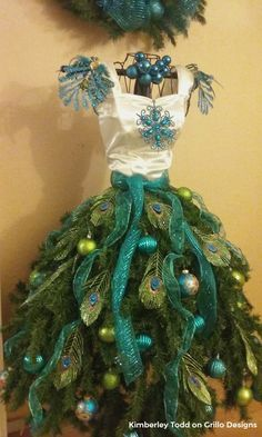 peacock feathered mannequin tree dress form / www.grillo-designs.com