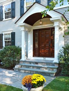 Extraordinary Entry Doors decorating ideas for Magnificent Entry Traditional design ideas with arched entry black shutters black window shutters bluestone bushes columns covered patio